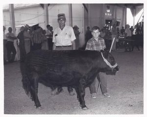 Harold Hartrich (left) at the 1969 Jasper Co. 4H auction.